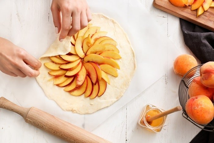Peach Galette Step by Step Instructions Step Seven: Add Peaches to Dough