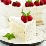 Amazing White Cake With Raspberry Filling And Whipped Cream Frosting