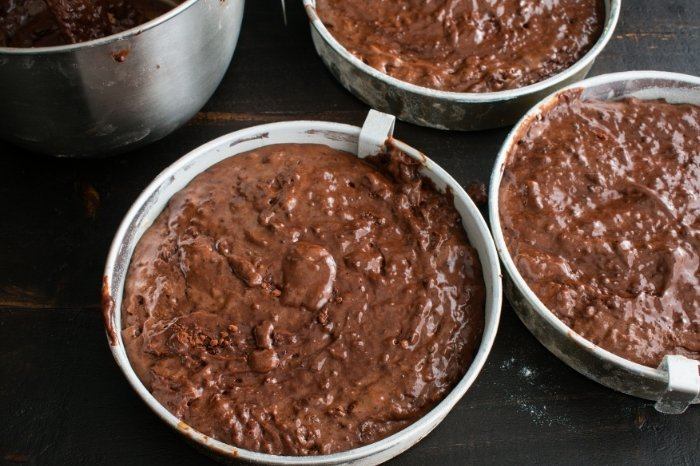 chocolate cake batter into pans